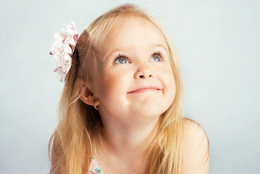 A little girl's hair styled