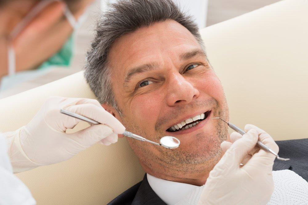 man getting dental implant