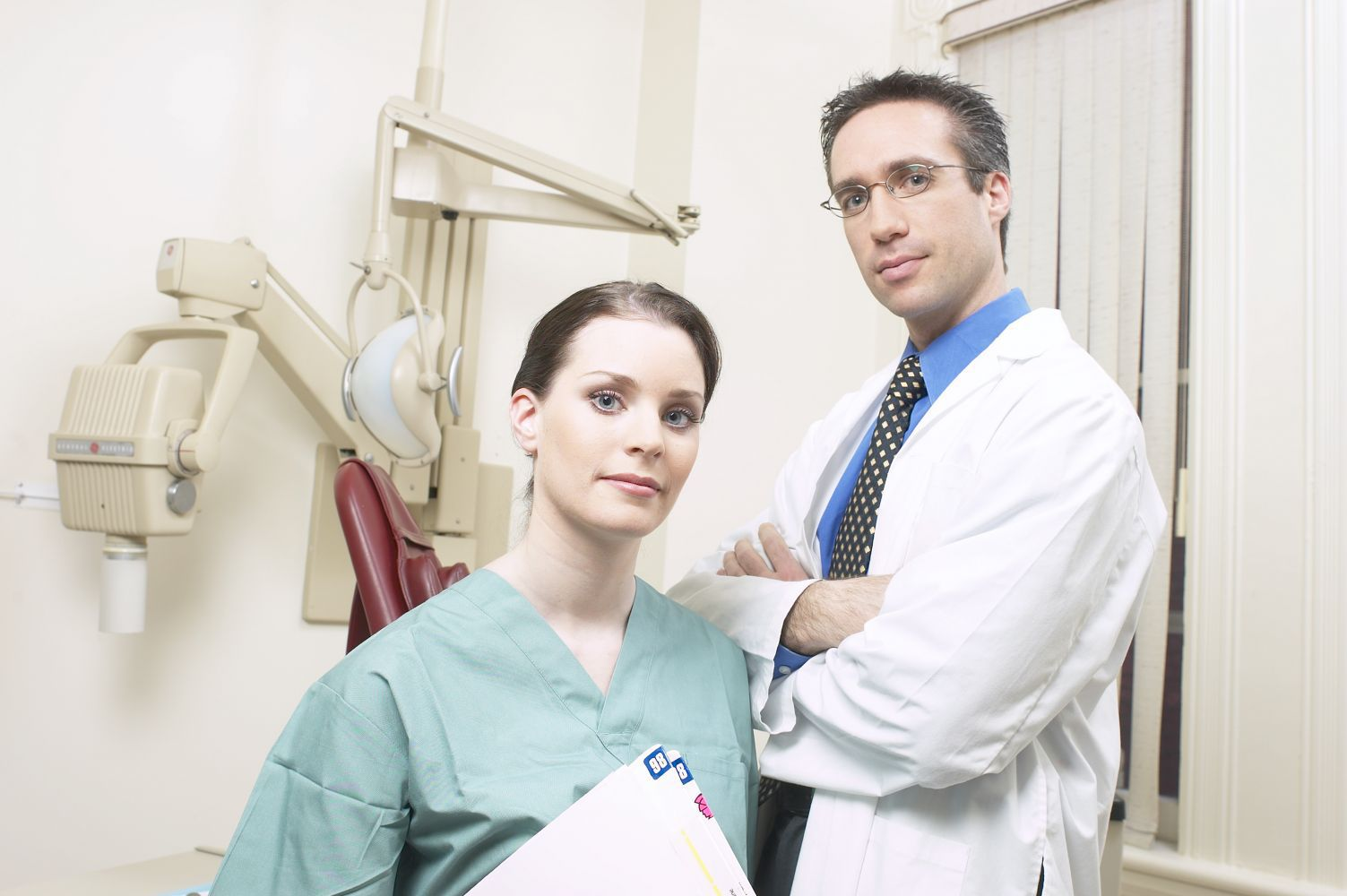 Dentist and his assistant providing dental health services in Anchorage, AK