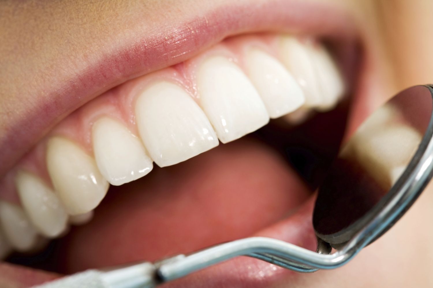 Dentist and assistant provide good oral hygiene to patient in Anchorage, AK