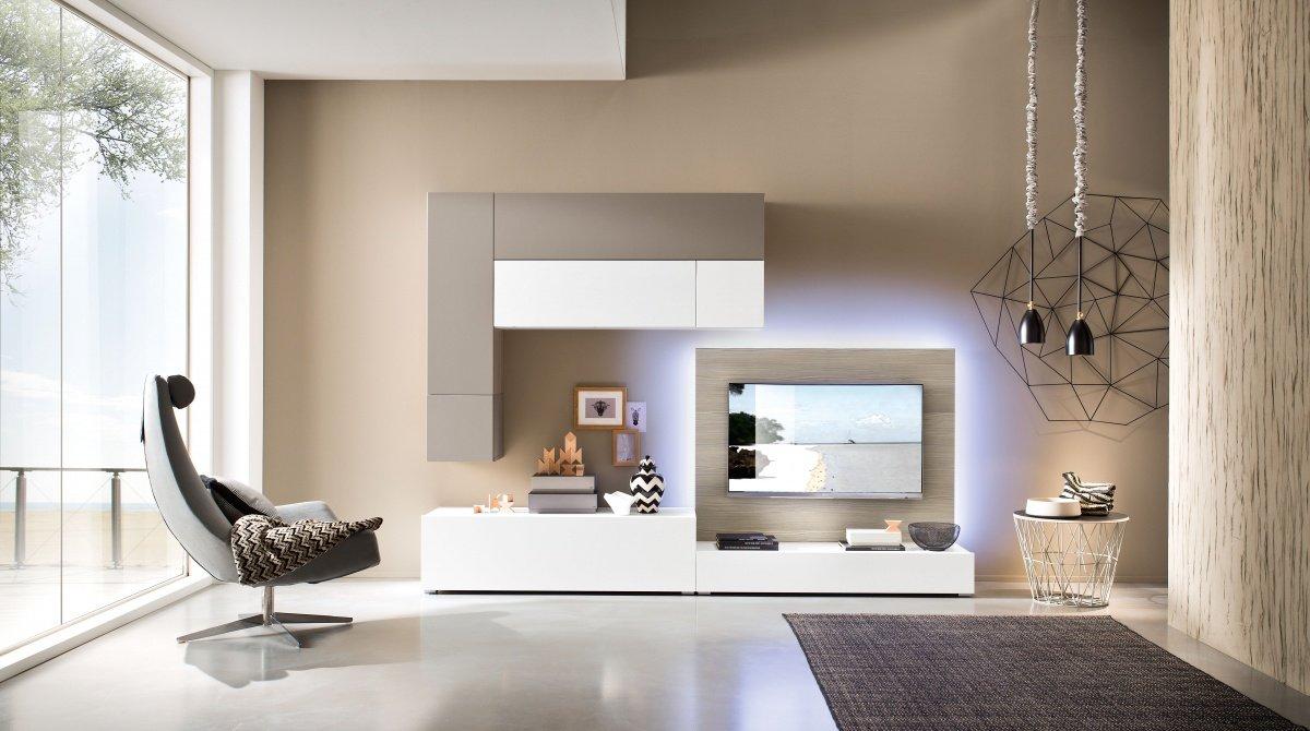 un mobile tv di color bianco e grigio con luci a led