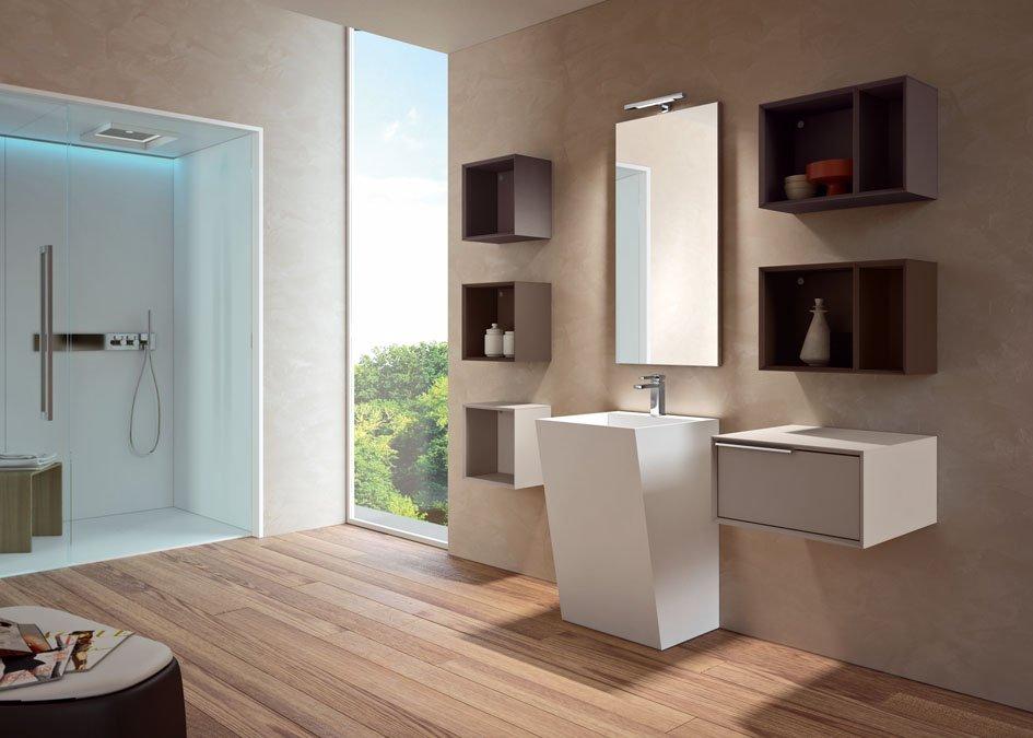 un bagno con un box doccia sulla sinistra con luci a led e sulla destra un lavabo