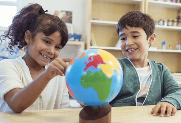 Children playing with map globe
