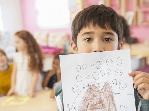 A child presenting his drawing.