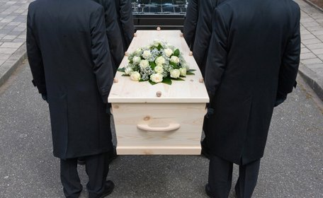 Coffin carried for burial