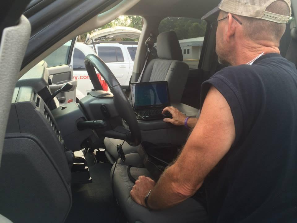 Locksmith with computer inside car, programming new key
