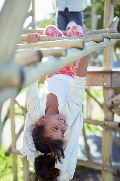 child hanging upside down