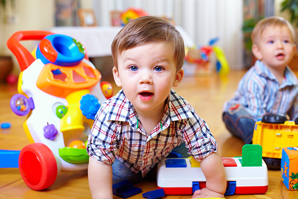 Small boy playing on floor