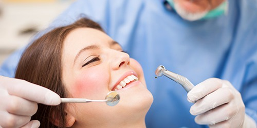 Woman getting a dental checkup by a trusted dentist in Columbia, MO
