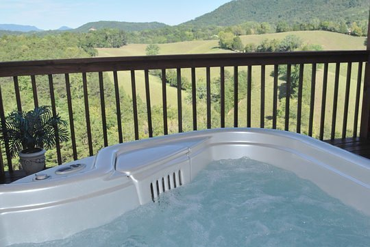 Hot tub on deck with smoky mountian view