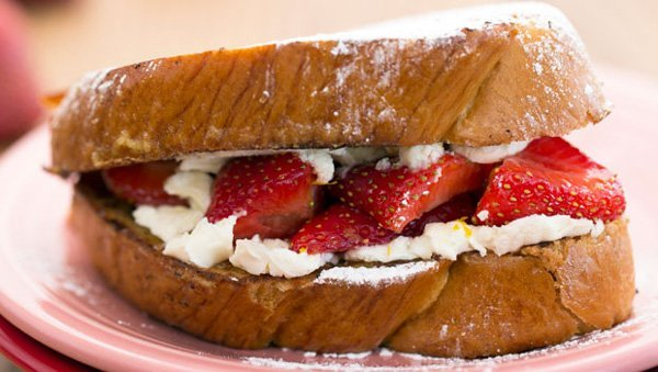 delectable sliced French bread griddled to perfection overlaid with macerated strawberries,