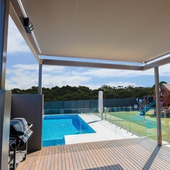 patio and pool with awning