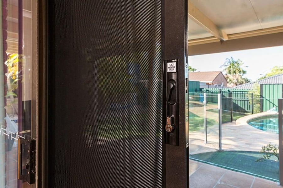security door with metal mesh