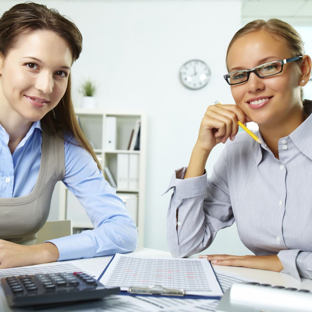 Two female bookkeepers in their office
