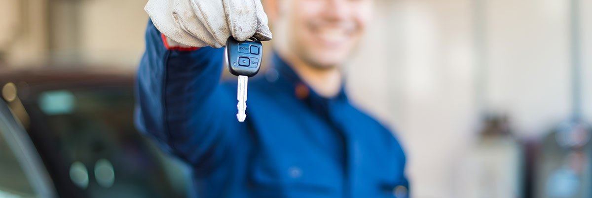 holding keys to car