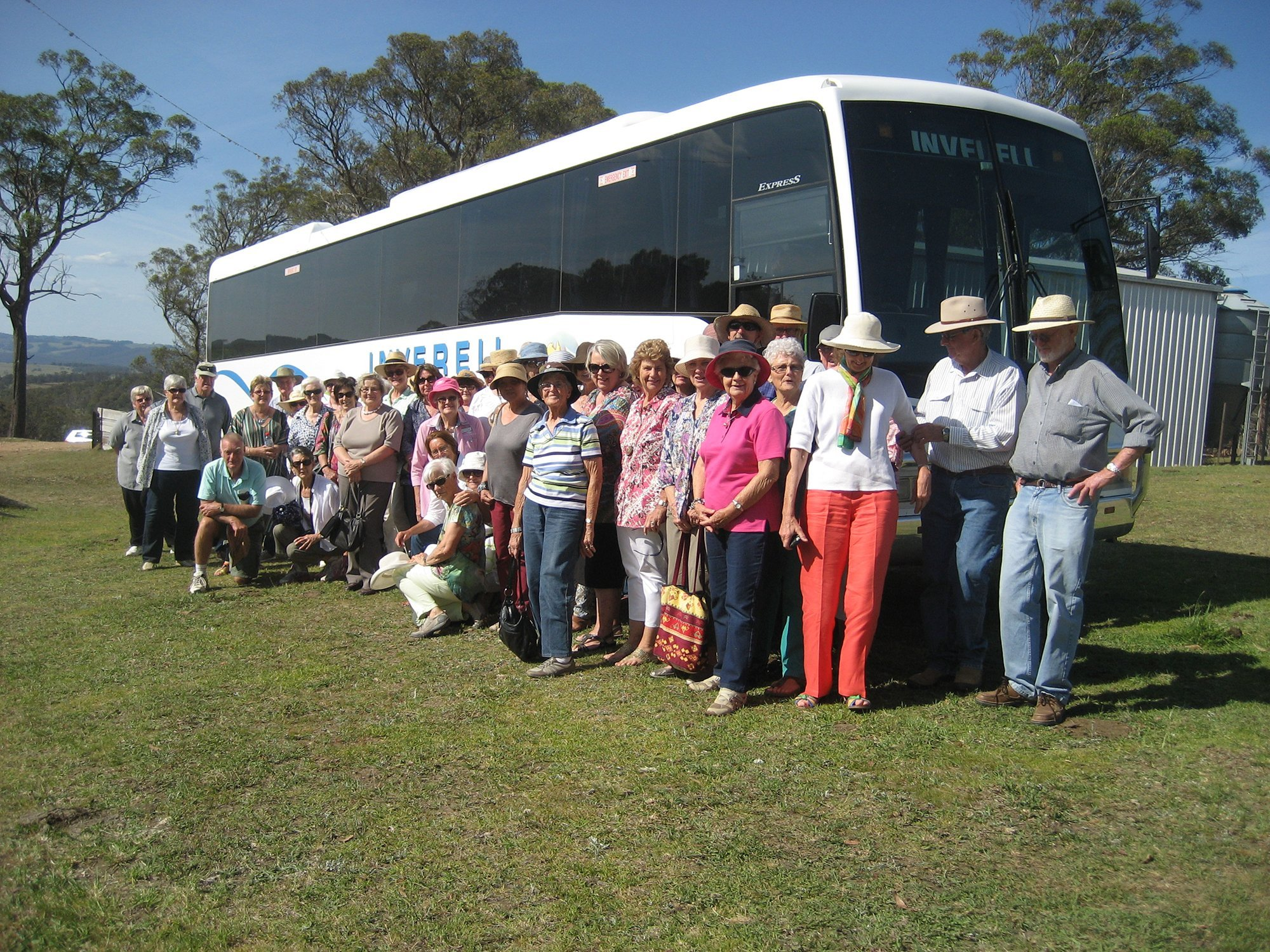 Group of tourist standing in front of bus
