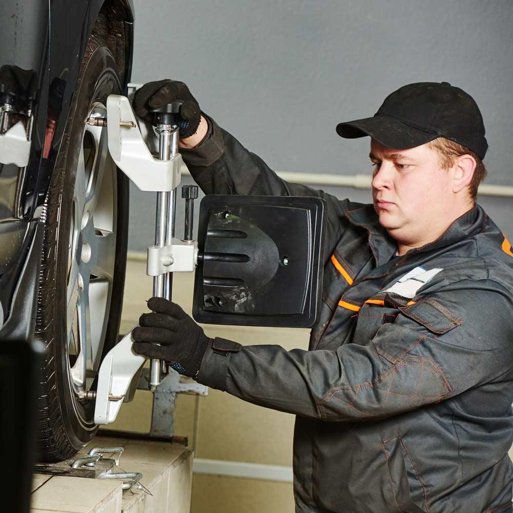 mechanic aligning tyres
