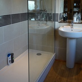 Walk in shower in a bathroom with a white sink