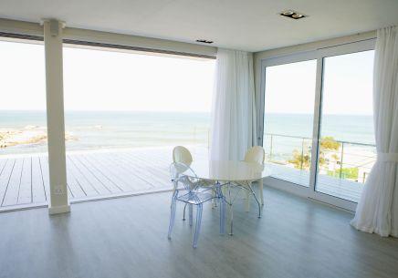 Aluminium sliding doors on beach house