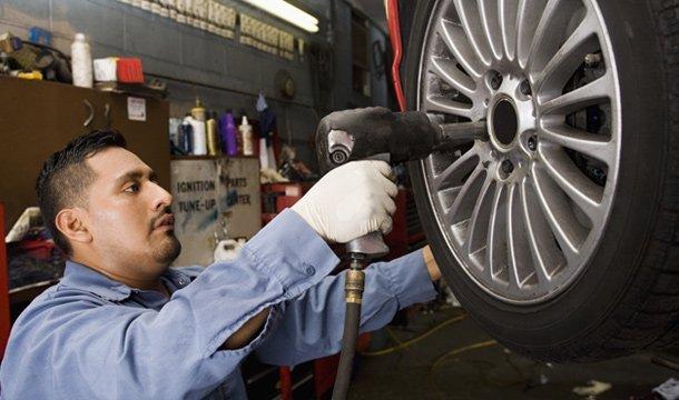 a b truck rentals mechanic fixing tyre