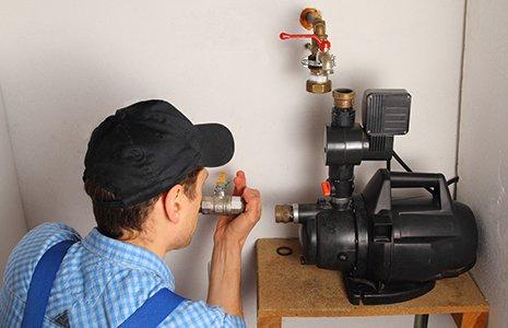Man installing a water pump in Summersville