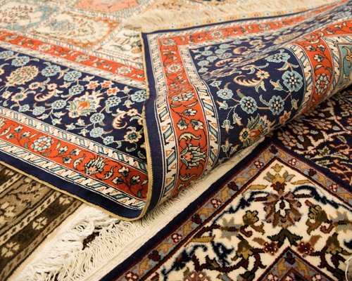 A pile of patterned rugs
