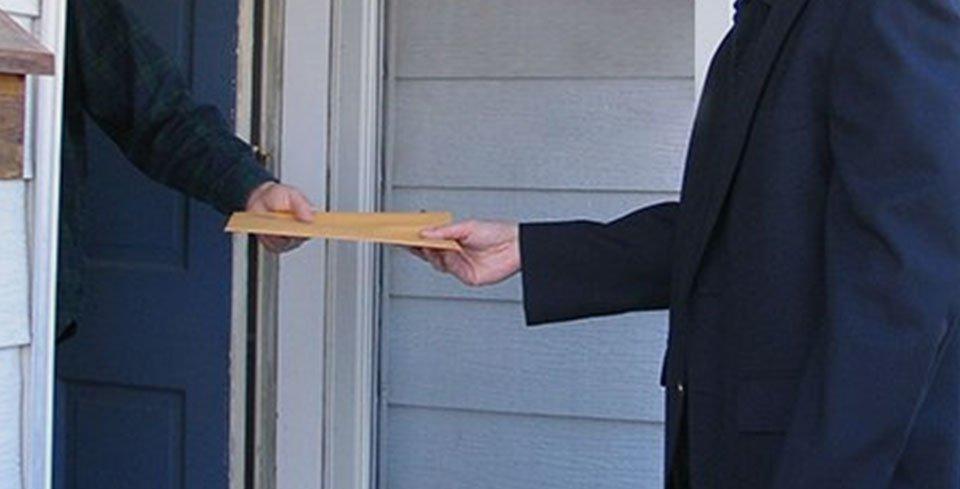 handing over the parcel