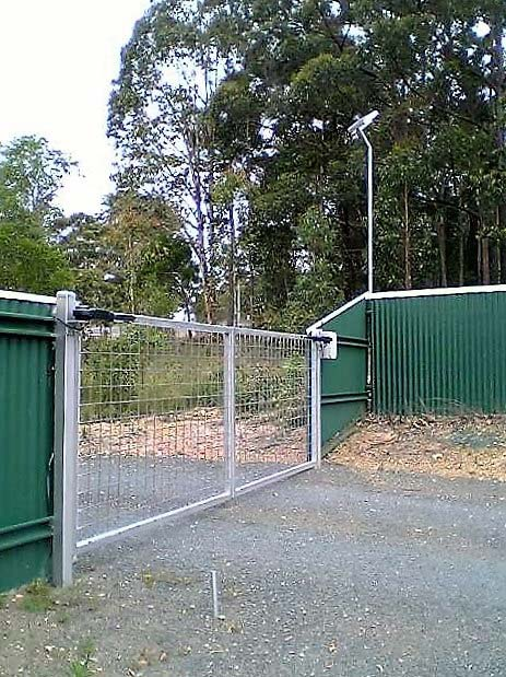 gate with green fencing