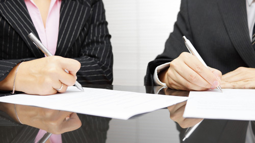 Business lawyers discussing legal matters in Honolulu, HI