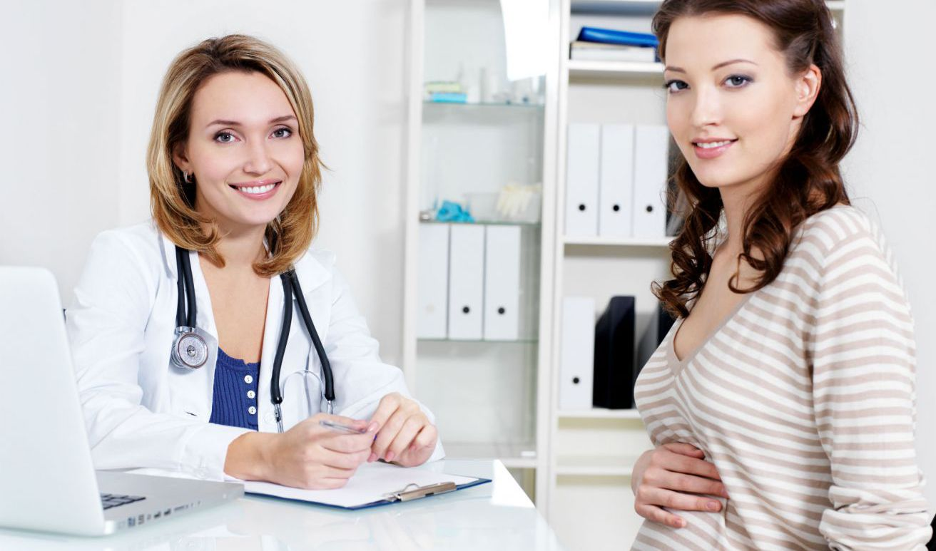 Women with doctor for a gynecological exam in Honolulu, HI