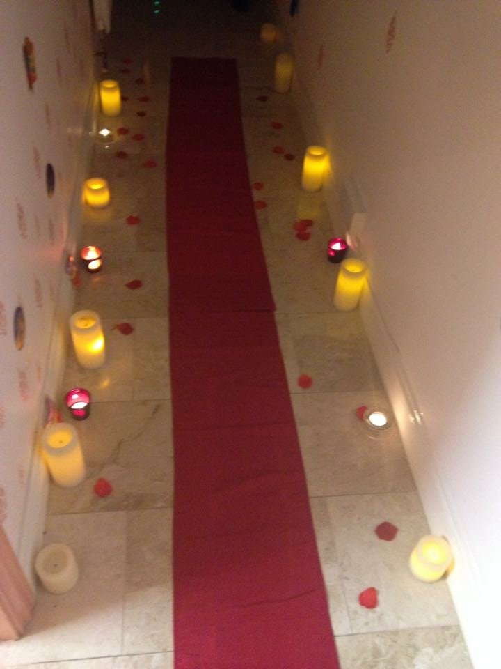 aisle decorated with aromatic candles