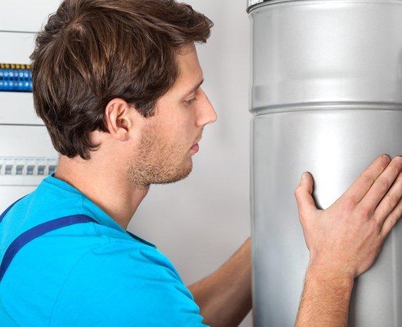 Man checking heating instrument