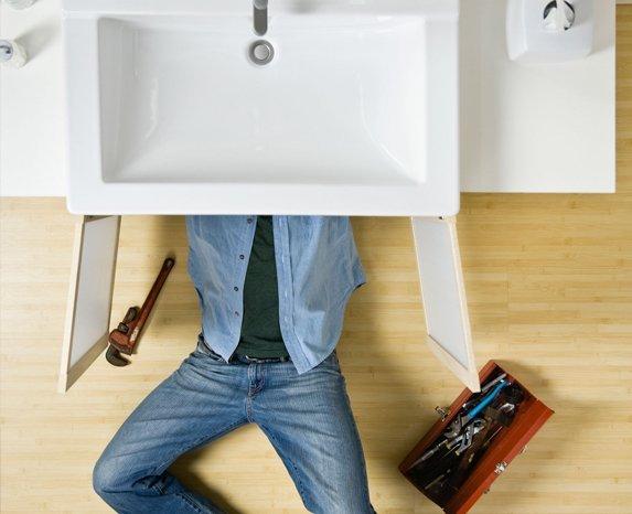 Man fixing leaky tap