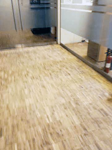 A light coloured wood effect floor