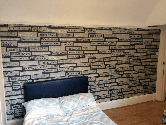 Cream and black brick effect feature wall