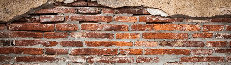 Brickwork showing on a wall in need of plastering