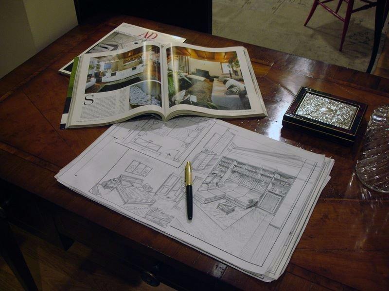 un disegno di un progetto di arredo e sopra una penna