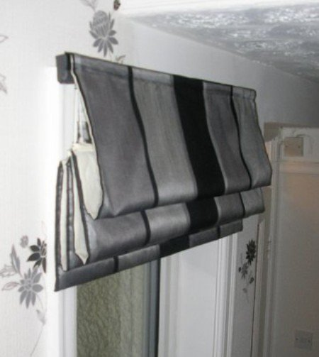 Ring top curtains in herringbone with contrasting cream sprigged panel