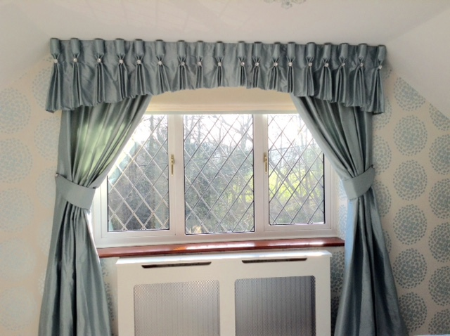 Dove grey curtains at a white window