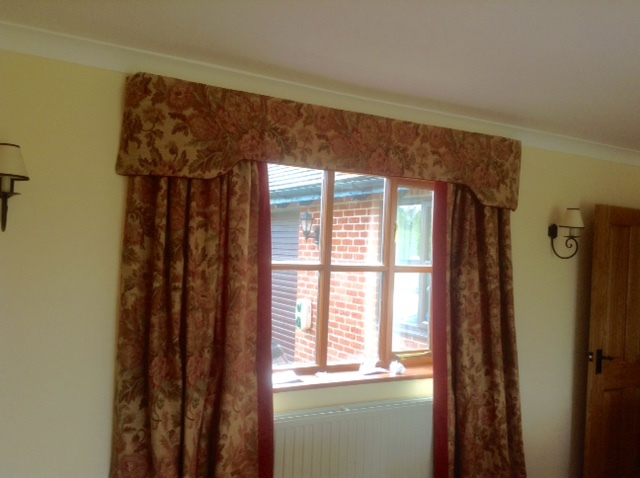 Terracotta patterned curtains against a pale yellow wall