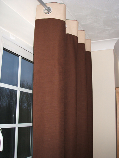 Long dark brown ring top curtains