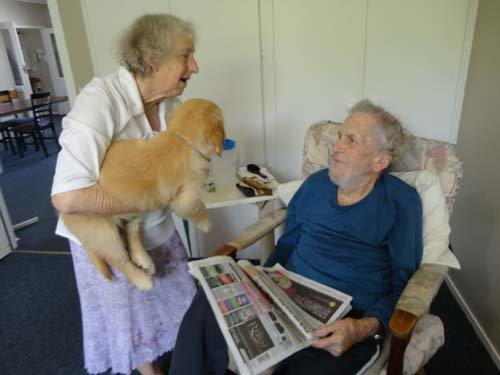 Old couple with their dog