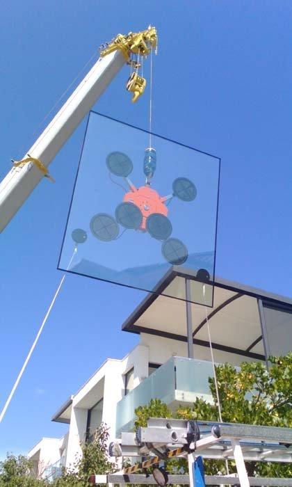 glass hoisted by crane