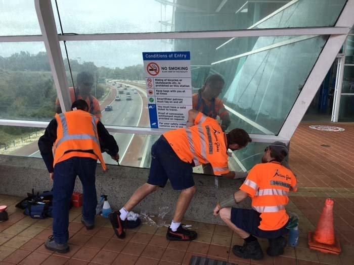 action glass men working