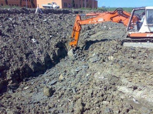 Macchina escavatore in azione