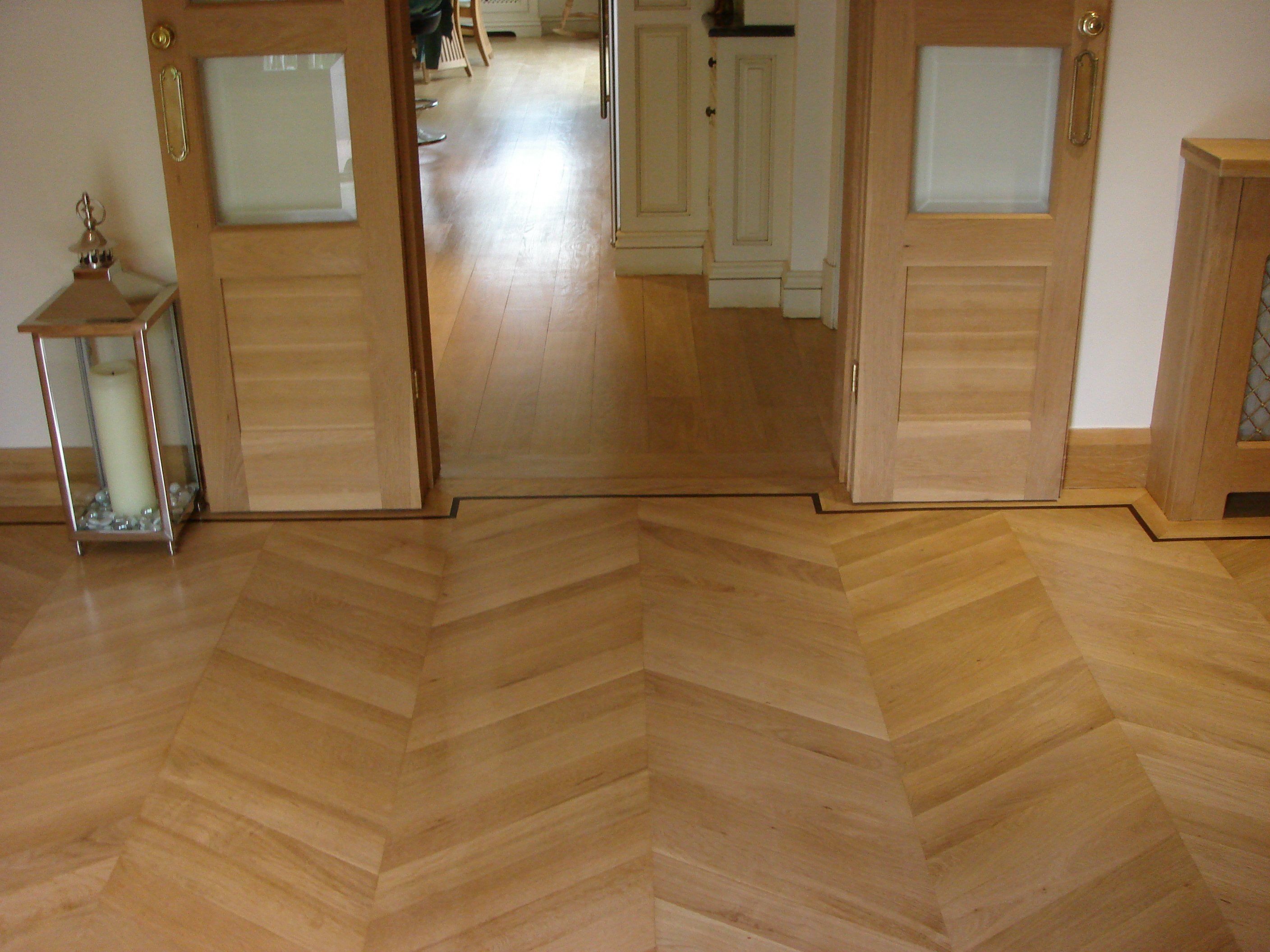parquet floor extended through series of rooms