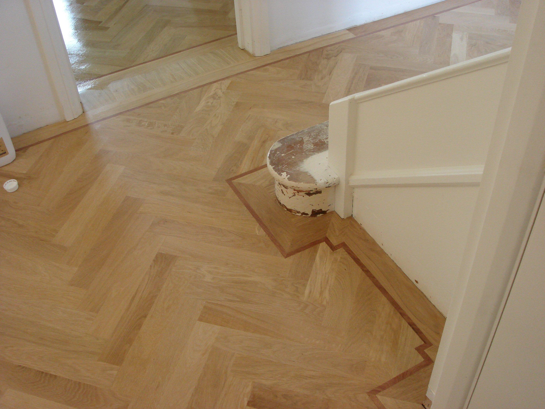 parquet flooring fitted around staircase riser