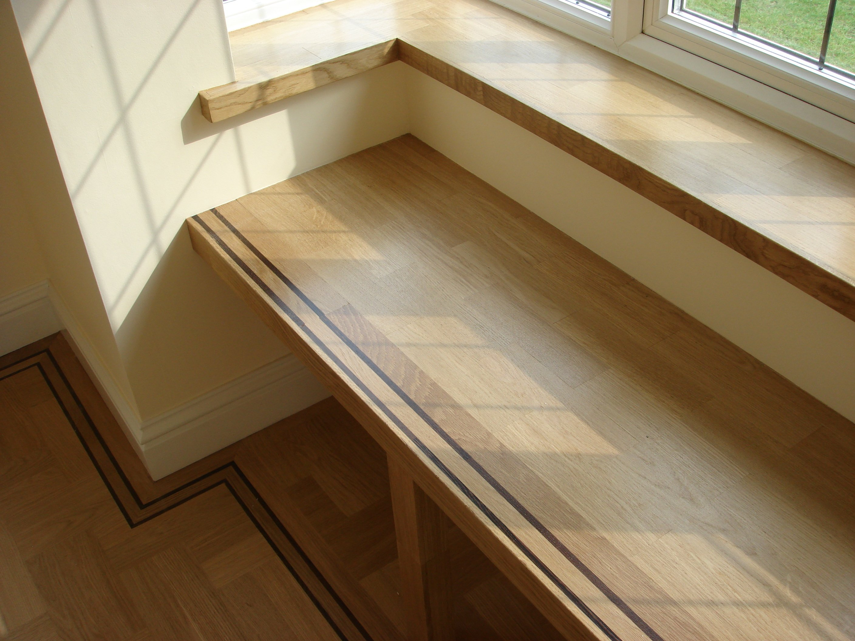 wood flooring fitted under built in seating