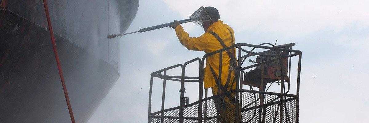 Island Paint Pro abrasive blasting employee paint blasting ship