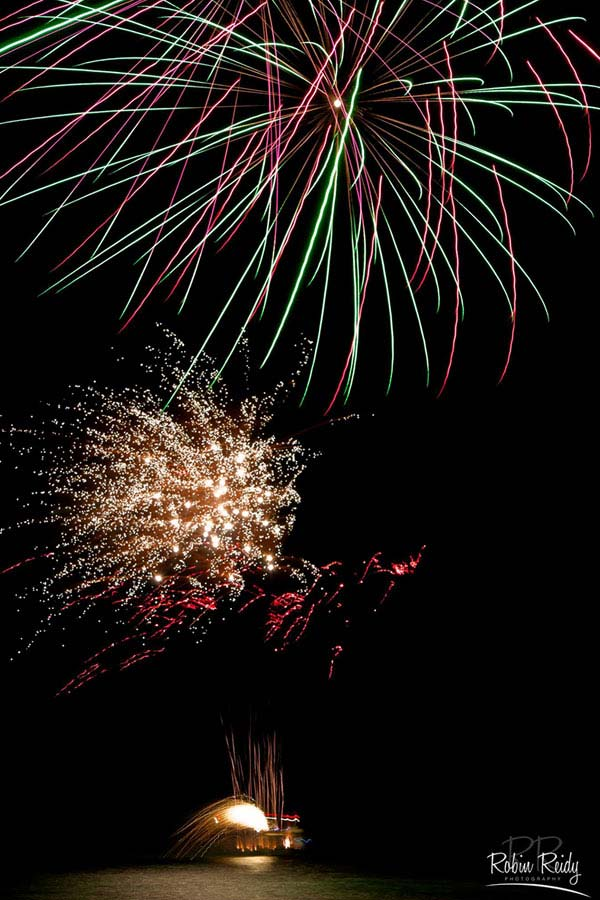 large private fireworks display over water